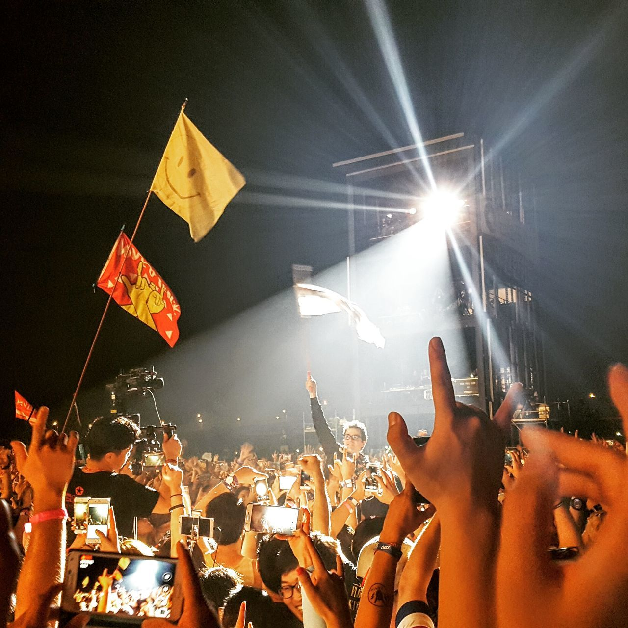 large group of people, crowd, real people, men, music, enjoyment, fun, night, event, arts culture and entertainment, nightlife, leisure activity, illuminated, women, audience, lifestyles, youth culture, performance, togetherness, popular music concert, outdoors, human hand, people