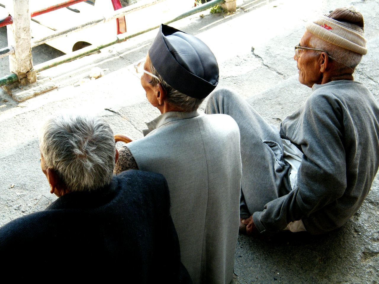 Remebering their old days. 3 best friends forever Rear View Casual Clothing Lifestyles Men Leisure Activity Sitting Street Person Outdoors Mature Adult Looking Bestfriends Three Old Traditional Clothing Remembering Old Times EyeEm Best Shots Chitchat