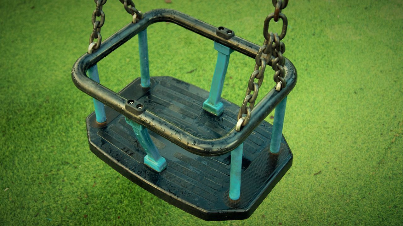 Day Grass Green Color Metal No People Outdoors Park Play Area Swing