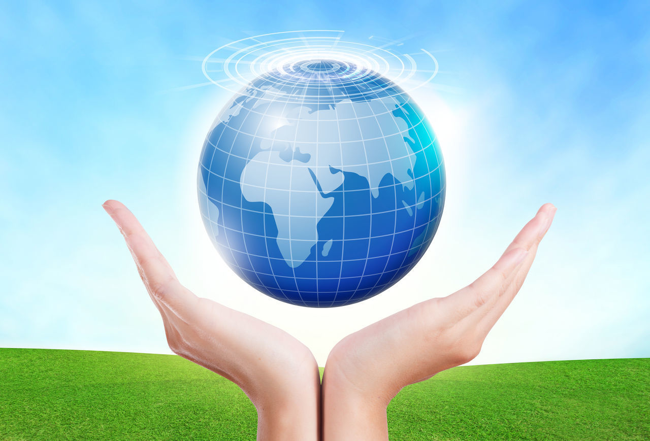 sphere, planet earth, planet - space, sky, shape, green color, grass, holding, global communications, nature, blue, human hand, day, cloud - sky, one person, human body part, real people, outdoors, space, cyberspace, people