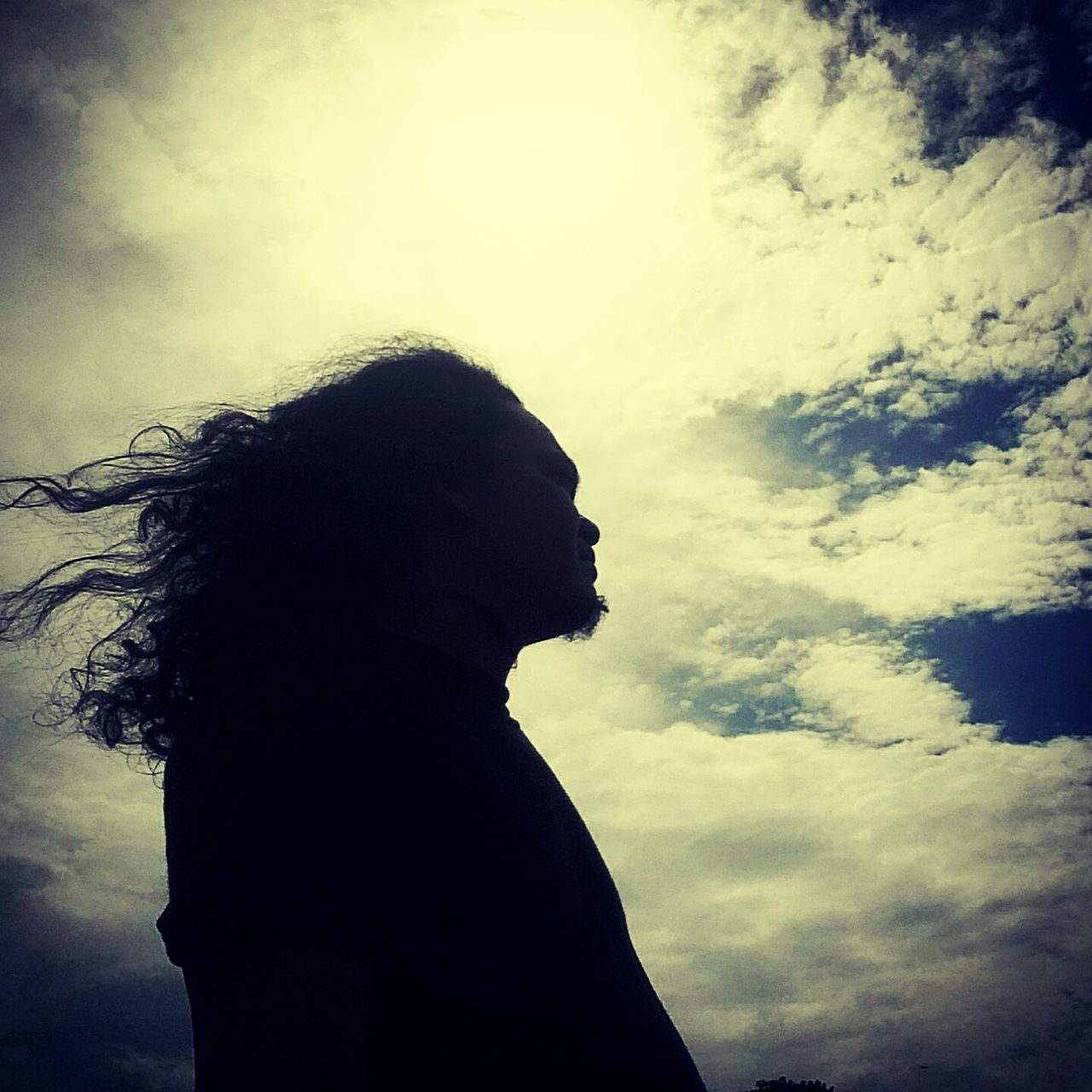 silhouette, one person, sky, real people, side view, lifestyles, cloud - sky, standing, day, leisure activity, outdoors, nature, young adult, people