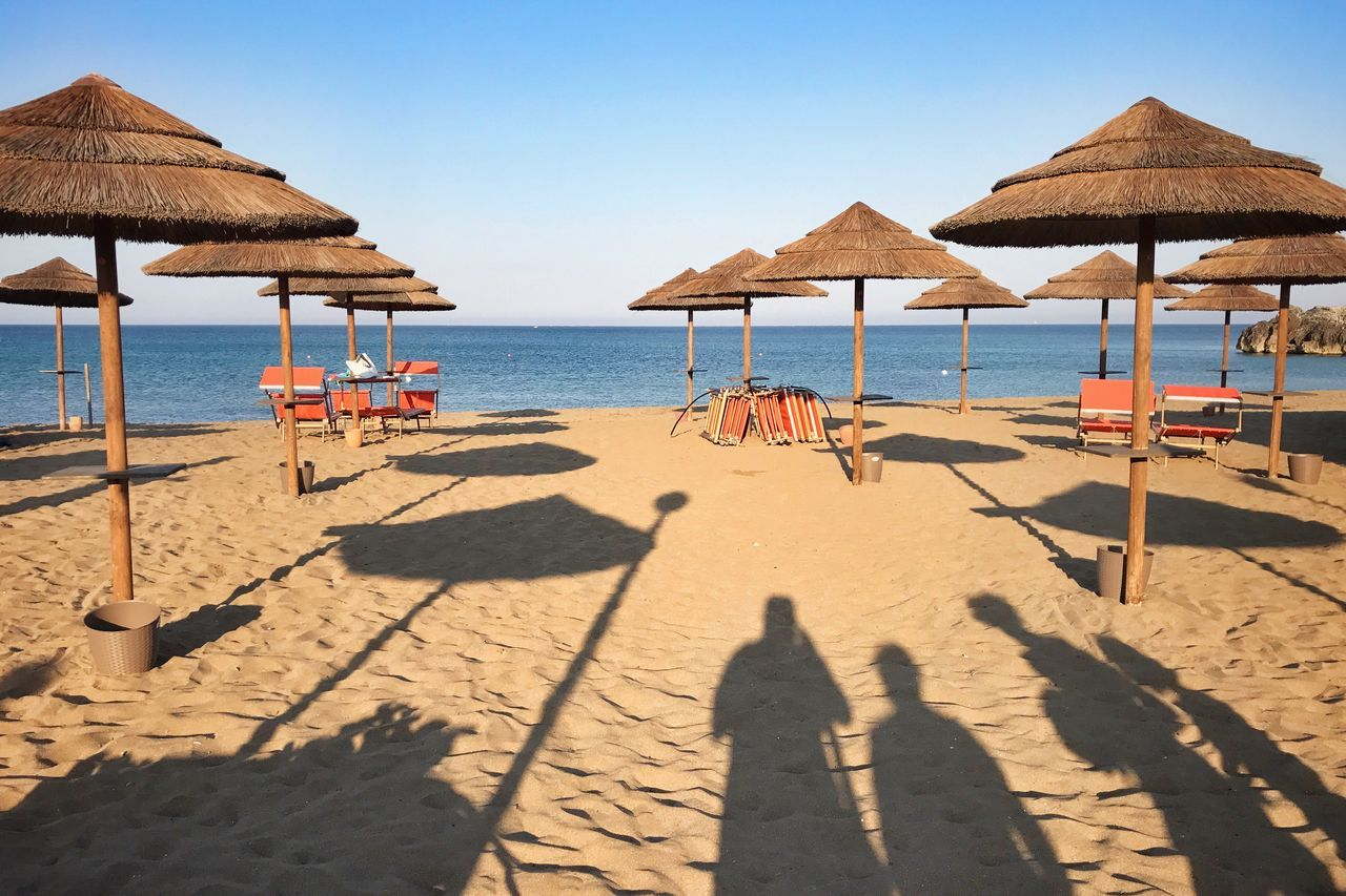 Costa Orientale - Sicilia Sunset Sunset Silhouettes Sea View Life Is A Beach Lifestyle Life In Colors Beauty In Nature Beach Sand Shadow Sunlight Sea Nature Shore Water Day Beauty In Nature Outdoors Sunny Summer Thatched Roof Scenics Tranquility Horizon Over Water Clear Sky No People Sky