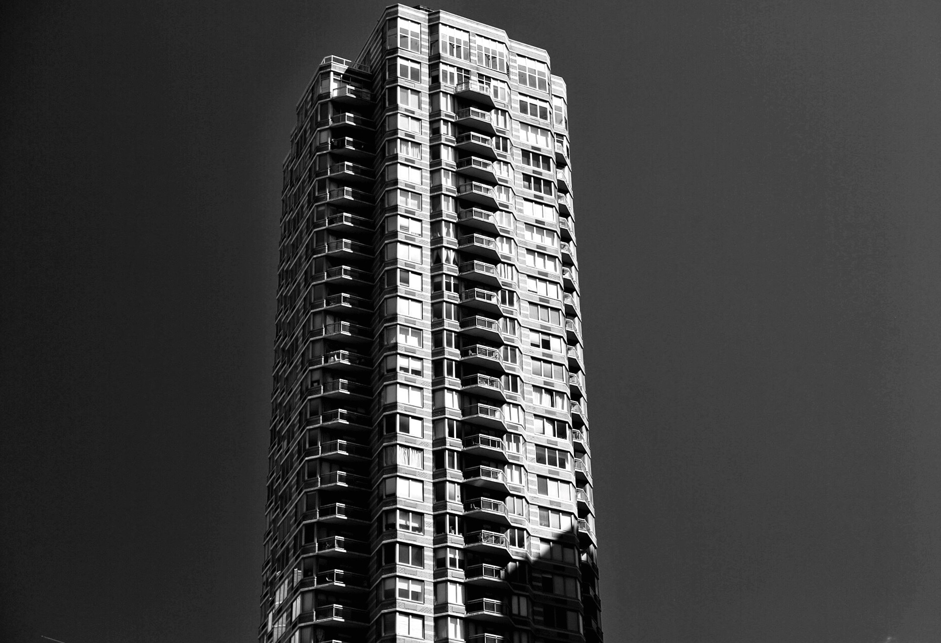 architecture, building exterior, built structure, tall - high, city, skyscraper, low angle view, tower, modern, sky, apartment, building story, office building, outdoors, tall, development, urban skyline, city life, financial district, no people, residential district, capital cities, architectural feature
