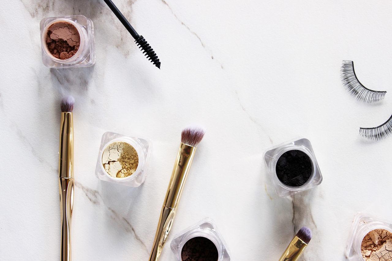 Pretty woman Copy Space Eyeshadow Fashion Gold Shades above background beauty brushes cosmetics cosmetology eyelashes glamour luxury make up marble mascara mineral mock up neutral palette powder styled tools