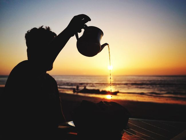 The legend of the tea pourer on the ocean // Legzira Morocco Tea Pouring Sunset Beach Silhouette Mirrorless Olympus