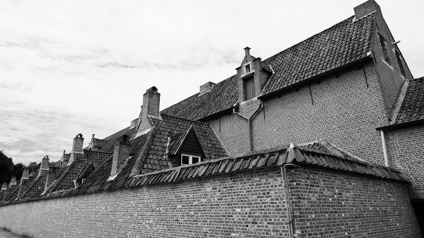 Architecture Building Exterior Built Structure Low Angle View Sky Roof Outdoors Day History Architecture_collection Travel Destinations Tiled Roof  Monochrome Daylight SONY A7ii EyeEm Gallery Brick Wall Bricks Brick Building Black & White Black And White Photography Black And White Architectural Building Old