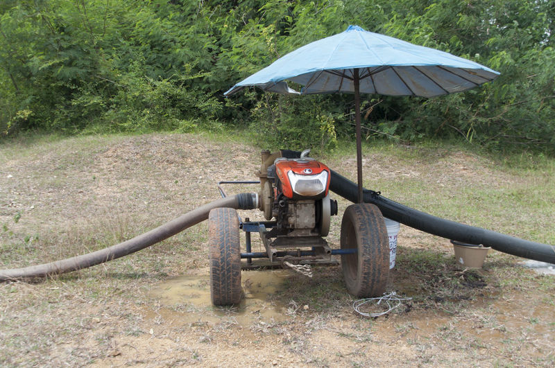 Pumping water into the fields Day Fashion Outdoors Pump Water Pumpkin Sunny Tractor Water