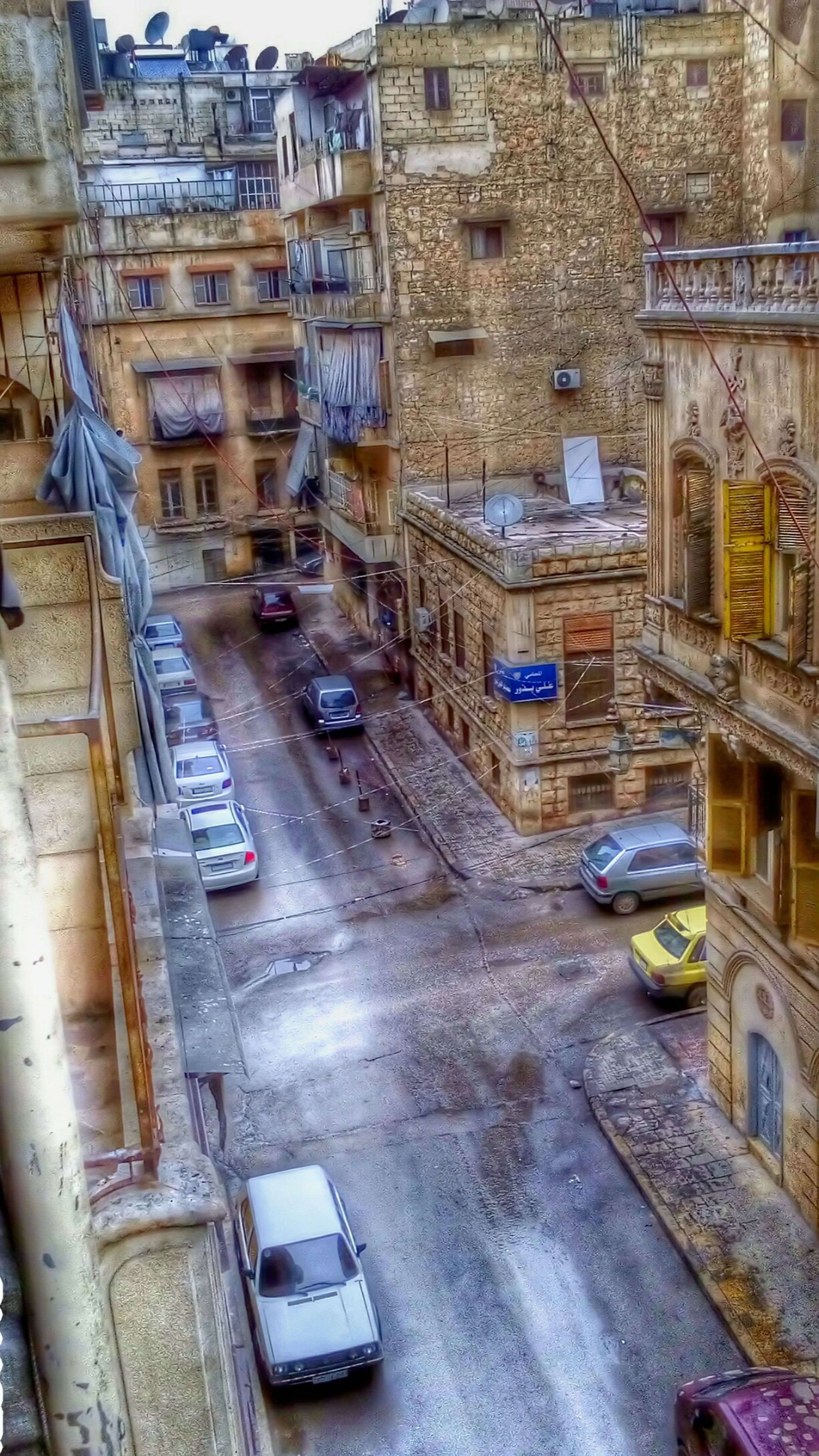 building exterior, city, high angle view, architecture, transportation, street, built structure, road, car, outdoors, land vehicle, winter, no people, day