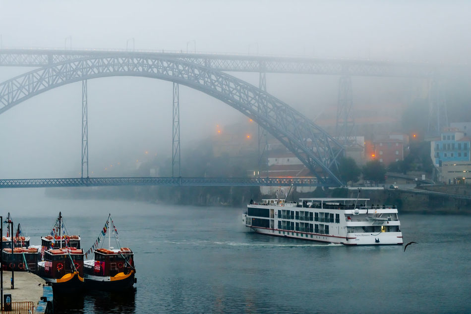 Architecture Bridge - Man Made Structure Built Structure Connection Day Douro  Ferry Fog Harbor Mode Of Transport Nautical Vessel No People Old Outdoors Passenger Craft Porto River Suspension Bridge Transportation Water Waterfront