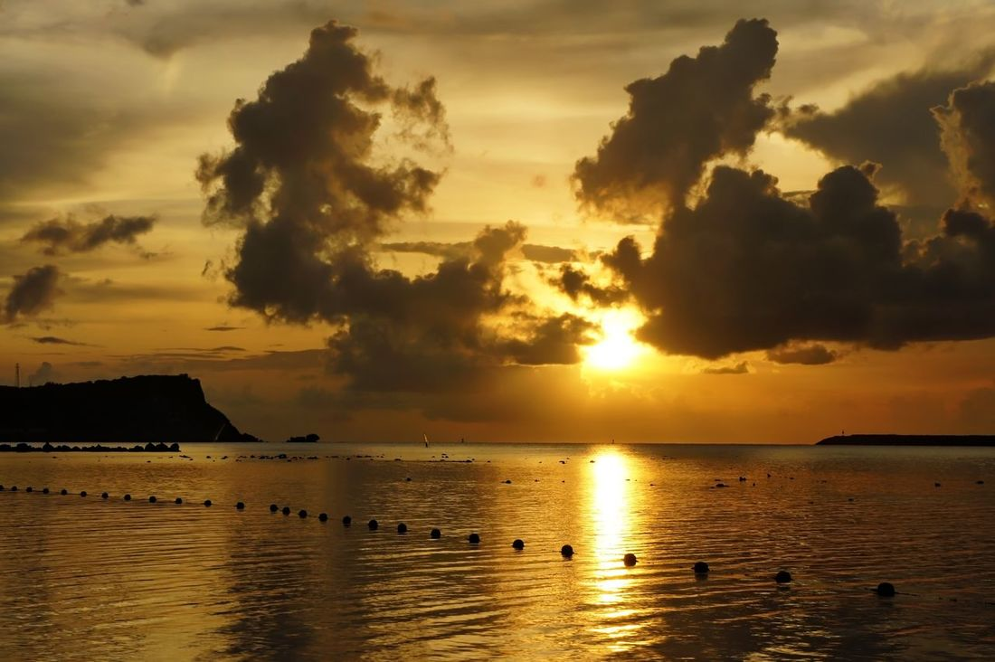 Sunset over GabGab Beach Beauty In Nature Calm Cloud Colour Of Life Dramatic Sky Guam Guamlife Guamsunset Home Is Where The Art Is Horizon Over Water Idyllic Majestic Nature Outdoors Reflection Remote Rippled Scenics Sky Sun Sunset Tranquil Scene Tranquility Water