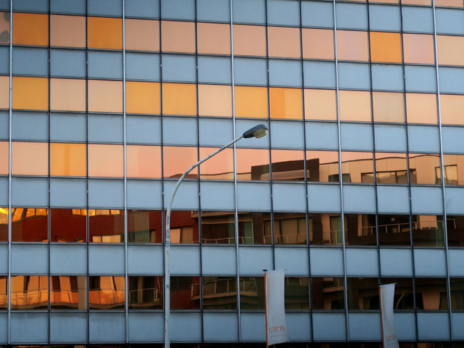Abstract Antwerp, Belgium Architecture Architecture Architecture_collection Building Exterior Built Structure Conformity Docks Ewandraful Geometric Shape Glass Wall Glass Wall And Its Reflections Harbour View Mirror Mirrored Reflection Orange Sky Pattern Pattern Pieces Pattern, Texture, Shape And Form Reflection Reflection_collection Reflections Sunset Sunset Reflection