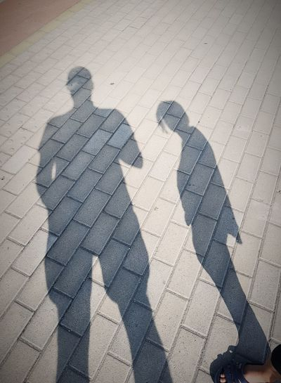 Shadow Togetherness Love Sand Day Men Bonding Outdoors Adult Adults Only People Playing With Shadows Black And White Father And Daughters Sunlight Fuel And Power Generation Shadow Photography