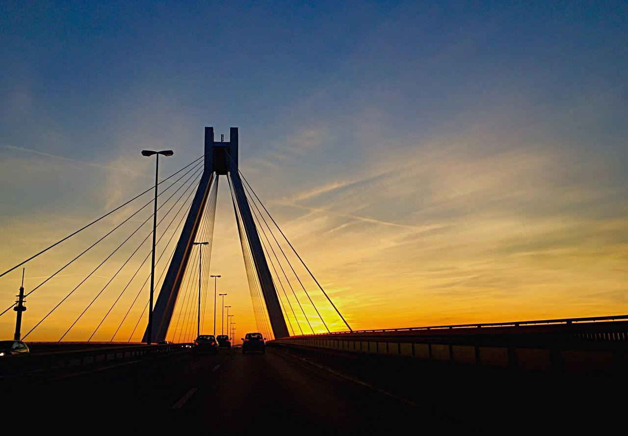 Sunset Silhouettes Bridge - Man Made Structure Sunset Connection Transportation Cable Engineering Outdoors Sky Building Exterior Suspension Bridge No People Road Built Structure Architecture Nature Electricity Pylon EyeEmbestshots EyeEm Gallery EyeEm Best Shots City View  City Life Architecture Cityscapes Mode Of Transport