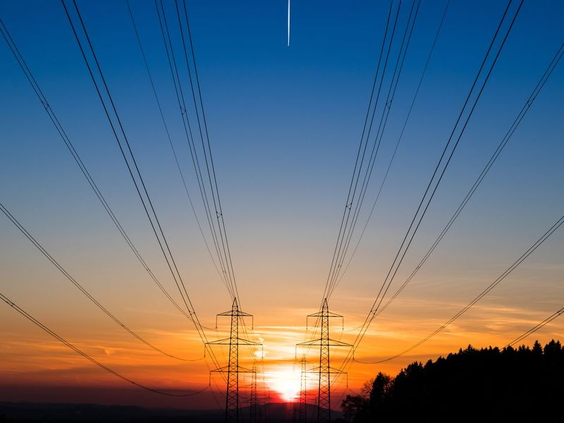 Power poles at sunset with contrail Power Lines Power Pole Sunset Silhouette Cable No People Sky Nature Outdoors Colorful Sky Colorful Sky And Clouds Contrail Condensation Trail Break The Mold