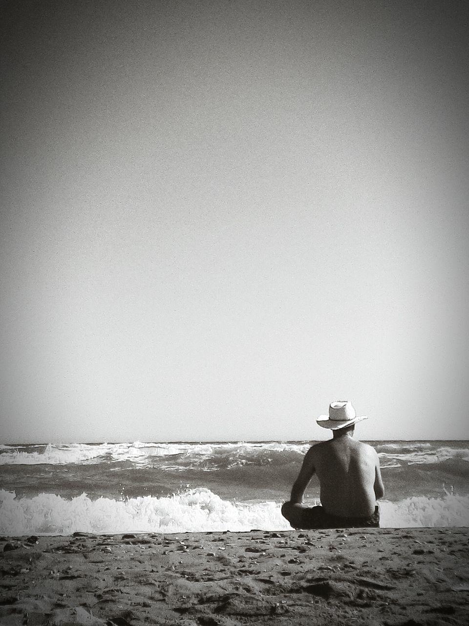 Tourist Sitting On Beach
