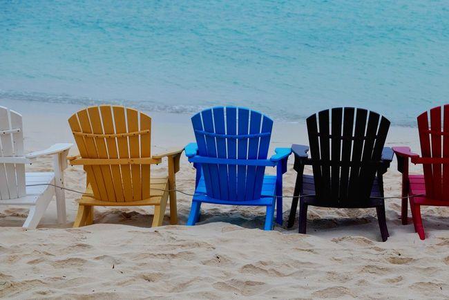 Good seats still available, Aruba. #onthebeach EyeEm Best Shots Sand Outdoors Eye4photography  Beach Aruba Photooftheday Color Chair Seats Water Ocean
