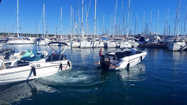 Transportation Water Mode Of Transport Nautical Vessel Sea Real People Outdoors Sailboat Large Group Of Objects Idyllic Transportation Catamaran Cityscape Yacht Sunny Sailing Ship Reflection In A Row Aquatic Sport Sailing Yachting Harbor