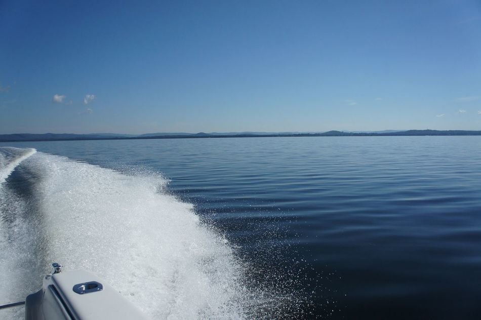 I love the way the camera caught the wake spray in this one and contrasts the undisturbed water Sea Water Lake Wave Horizon Over Water UnderSea Close-up Yachting Outdoors Blue Sky No People Speedboat Speeding Leisure Activity Backgrounds