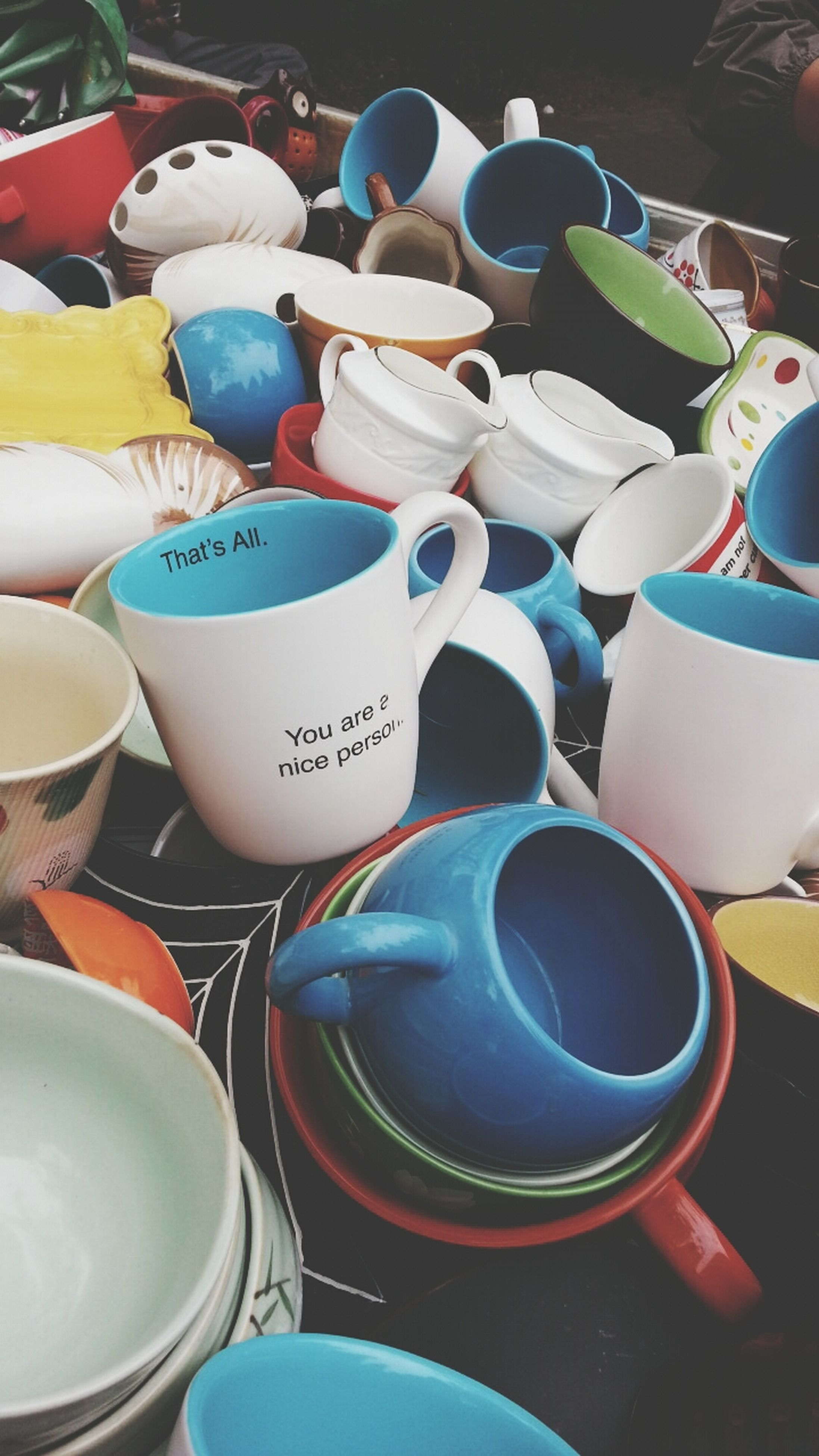large group of objects, variation, abundance, choice, still life, arrangement, multi colored, order, indoors, in a row, group of objects, stack, collection, high angle view, close-up, chair, table, no people, for sale, repetition