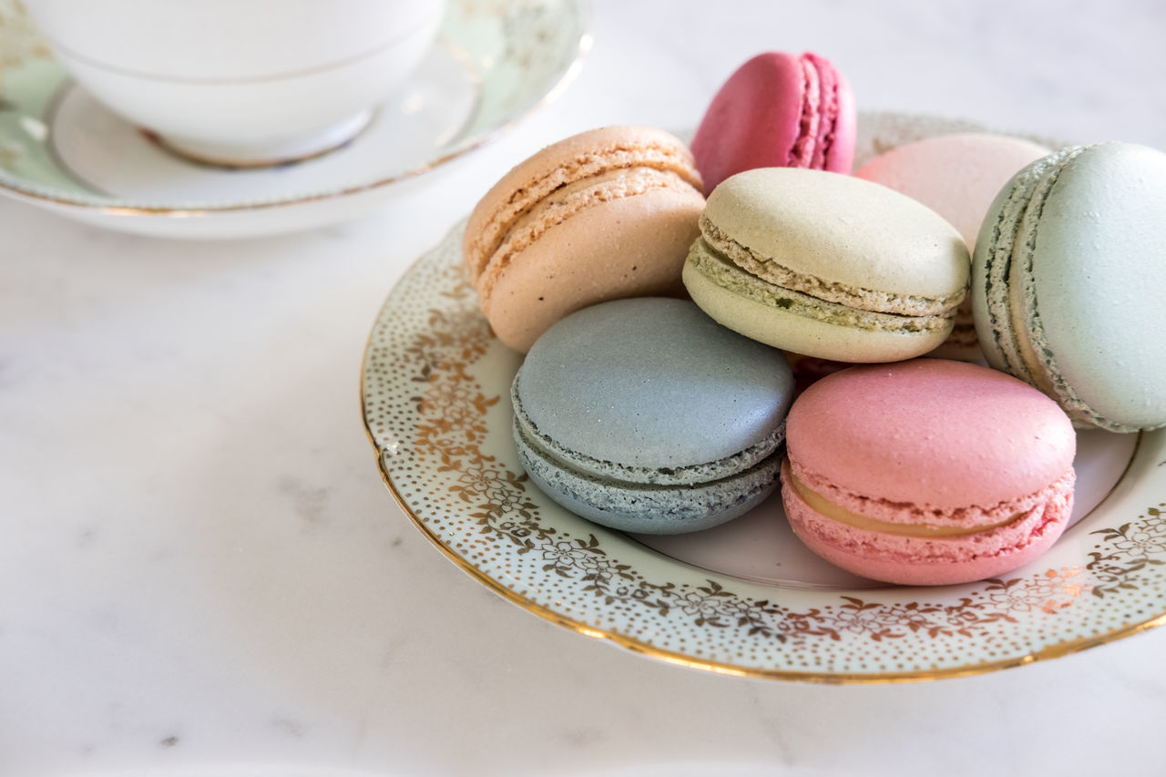 Close-up Coffee Cup Day Dessert Food Food And Drink Freshness High Angle View Indoors  Indulgence Macarons Macaroon Multi Colored No People Pink Color Plate Ready-to-eat Saucer Still Life Sweet Food Table Temptation
