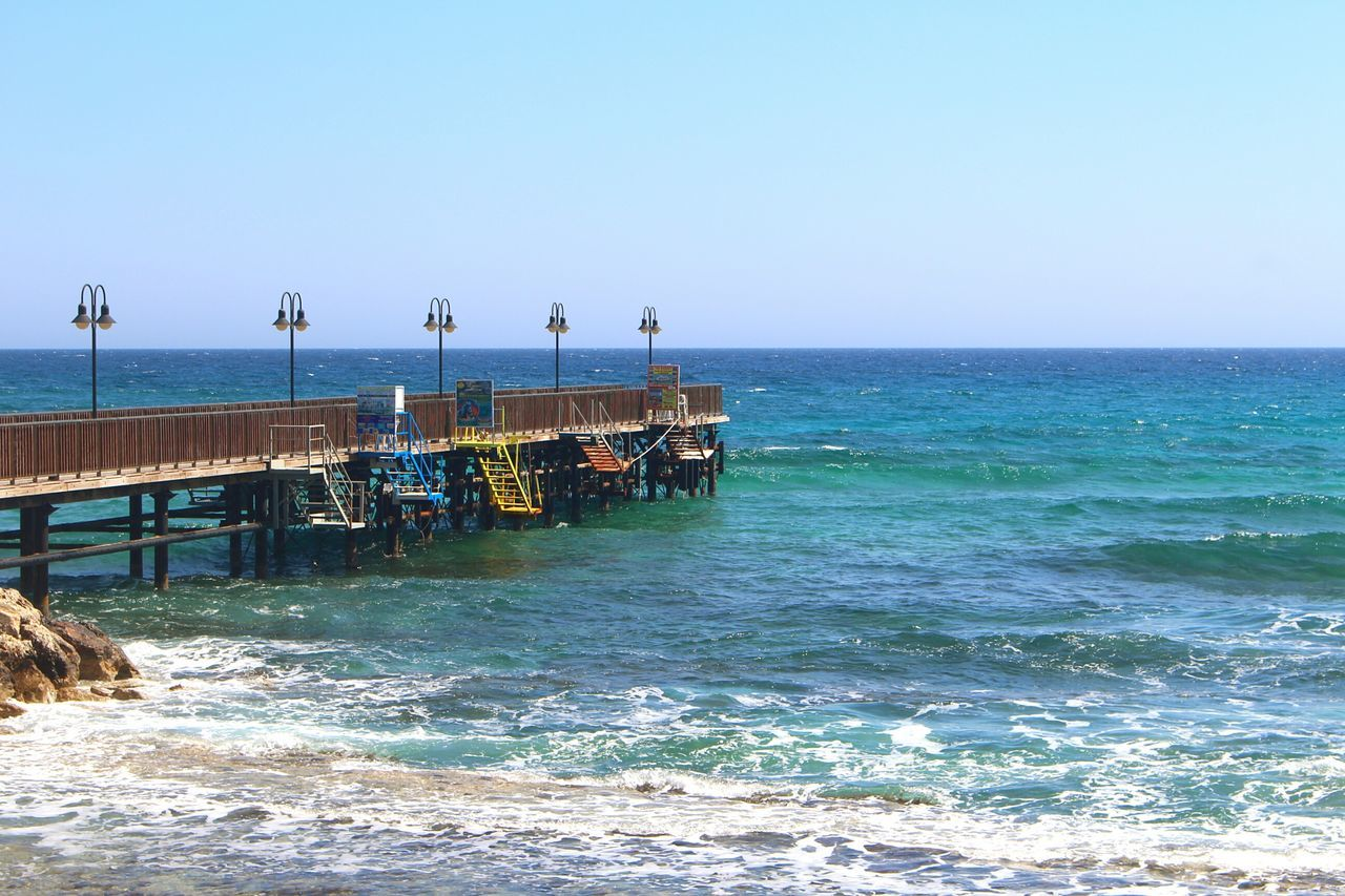 Wharf Quay Sea Nautical Theme Clear Sky Beach Water Outdoors Horizon Over Water Nature Day Popular Photooftheday Canon100D Canon Joaoaz90 Capture The Moment Leisure Activity Vacations Photographic Memory Landscape Tranquil Scene Mediterran Mediterraneo Beach Life