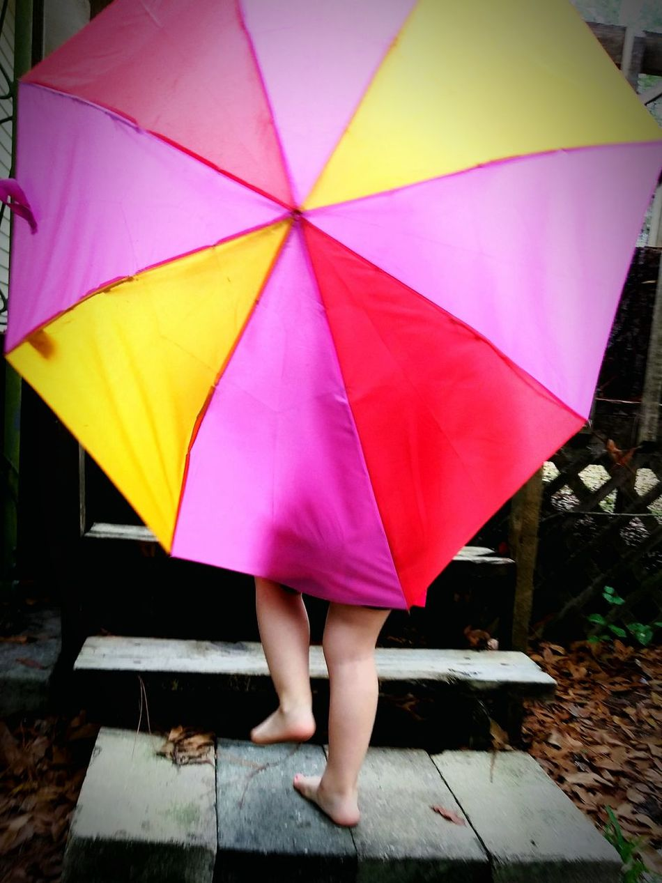 Rain And Rainbows Multi Colored Umbrellas Playing In The Rain Singing In The Rain From Behind Childhood People Family Weekends Spring Toddlers  Millennial Pink The Secret Spaces EyeEm Diversity Art Is Everywhere