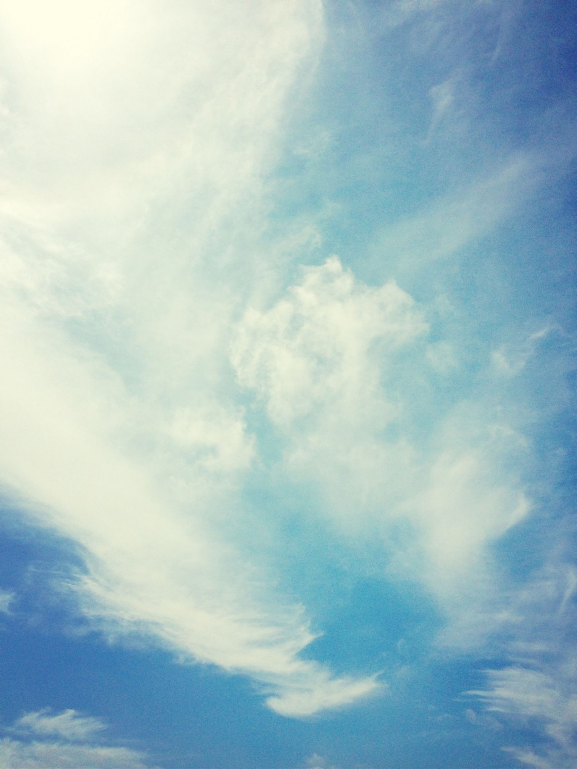 sky, low angle view, cloud - sky, blue, tranquility, beauty in nature, scenics, sky only, nature, backgrounds, tranquil scene, cloudy, full frame, cloud, cloudscape, idyllic, day, outdoors, no people, white color