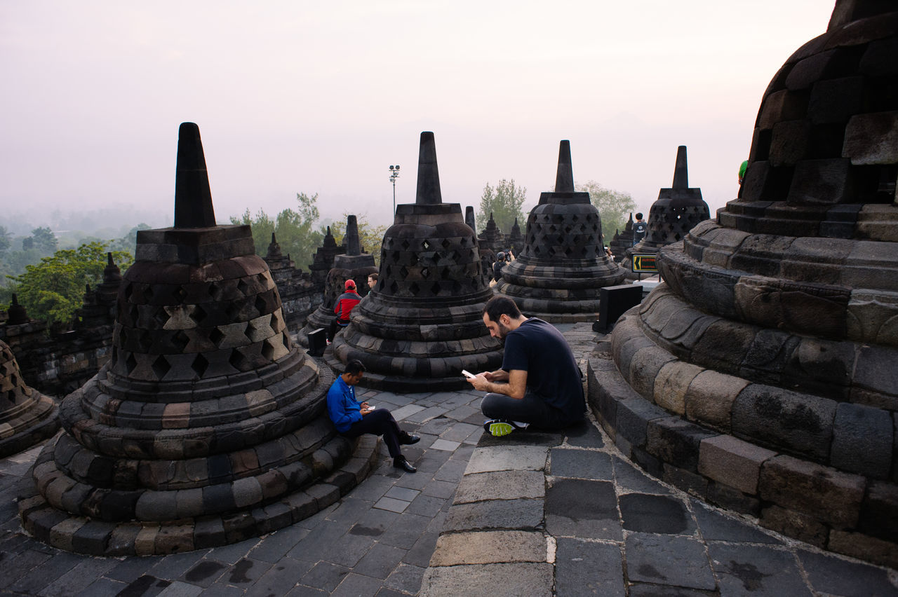 Ancient Ancient Civilization Borobudur Temple Clear Sky Day Famous Place Full Length History Internet Addiction Men Monument Old Ruin Outdoors Religion Sitting Stone Material Stupa Temple - Building The Past Tourism Tranquility Weathered People And Places The Photojournalist - 2017 EyeEm Awards