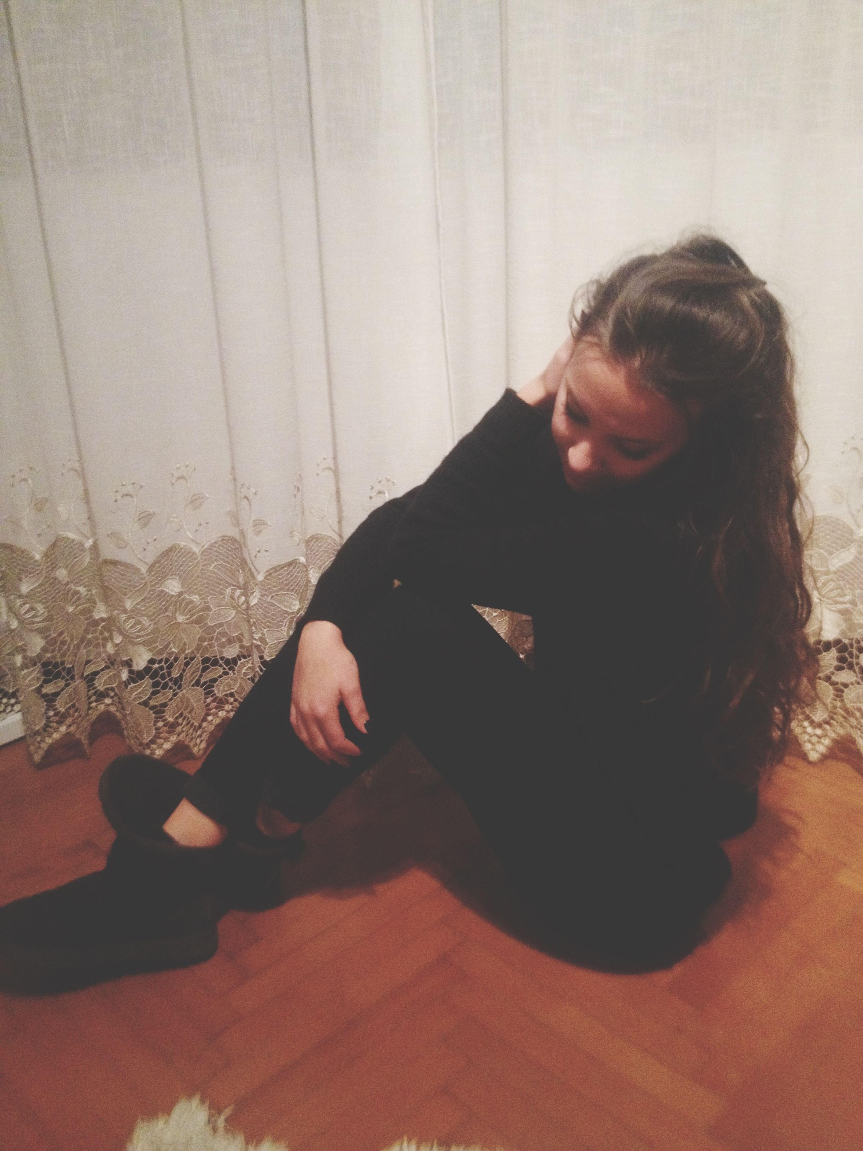 indoors, young women, lifestyles, young adult, person, leisure activity, casual clothing, home interior, long hair, relaxation, headshot, sitting, eyes closed, front view, waist up, contemplation, looking at camera