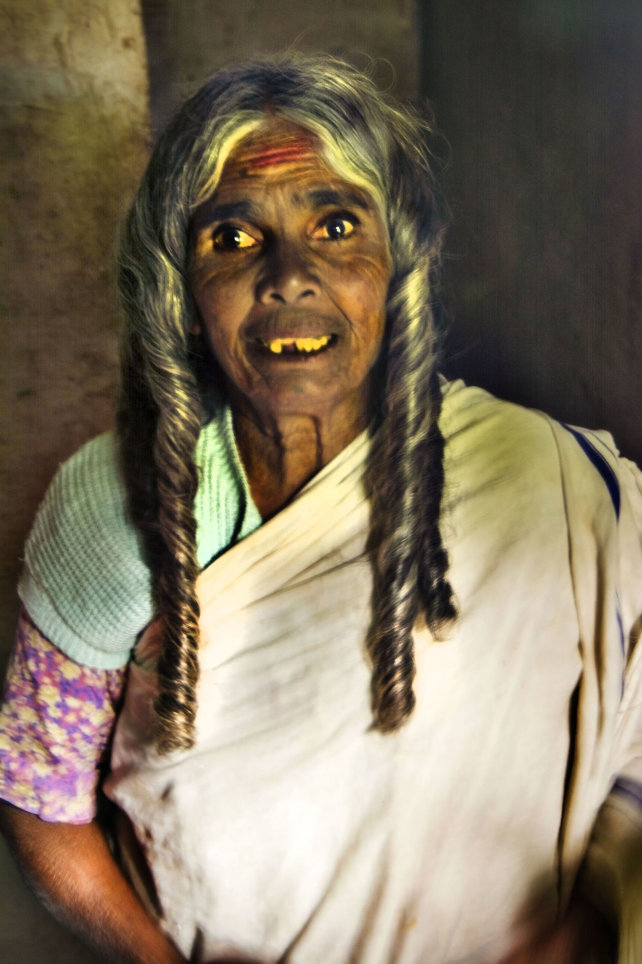 Old tribal lady Forehead Painted Hair Style Here Belongs To Me Looking At Camera Person Poor  Portrait Smiling Teeth Mi Traditional Costume Tribal Lady Waist Up