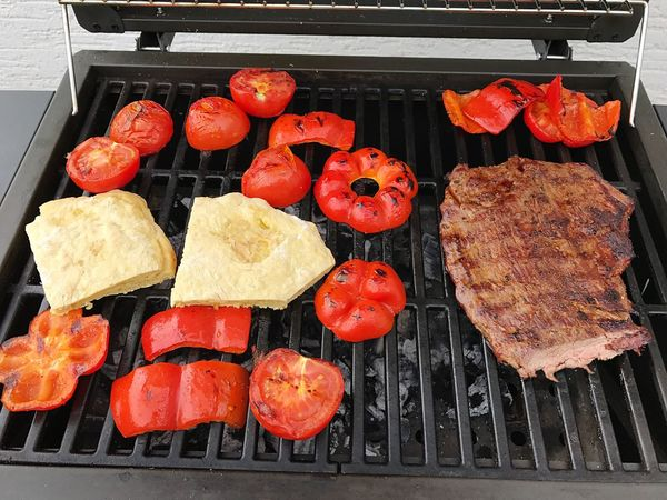 Grilled Barbecue Grill Food And Drink Meat Preparation  Food Barbecue Flank Steak  High Angle View Beef Bio Organic Vegetable Bread Freshness Charcoal Meal Cooking Summer Paprika Tomato No People Fire Close-up Outdoors