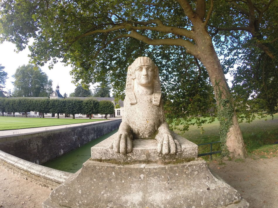 Sphinz statue in grounds of chateau Château France Sculpture Sphinz Cat Statue Tres