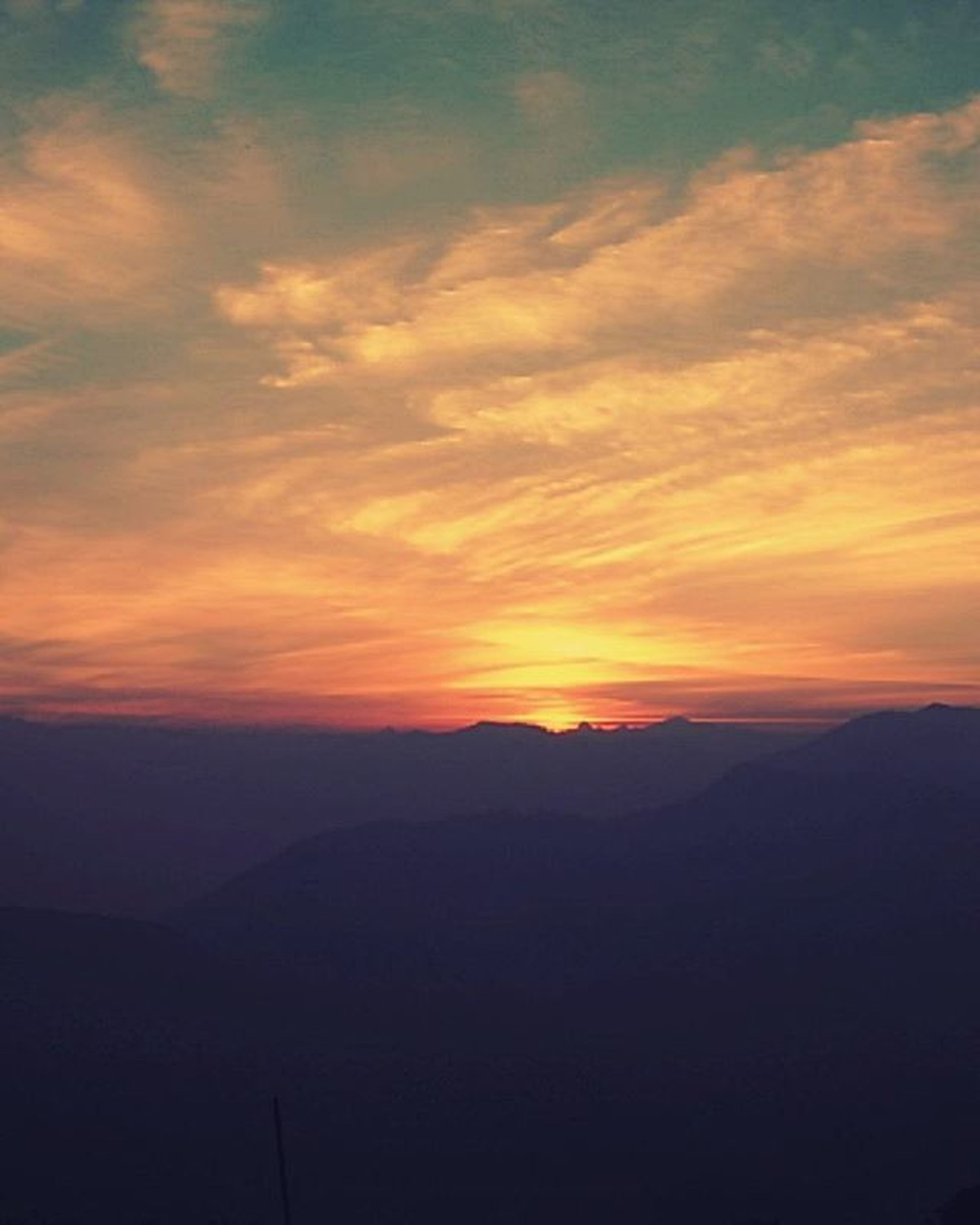 sunset, scenics, tranquil scene, tranquility, beauty in nature, orange color, mountain, sky, silhouette, landscape, idyllic, nature, mountain range, cloud - sky, dramatic sky, majestic, non-urban scene, cloud, outdoors, remote