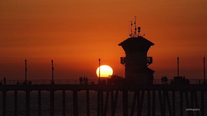 Sunset at Huntington Beach Orange County California Coast Beach Photography Beach Life Jnphotography Orange Color Sun Silhouette Scenics Sea Tranquility Sky Waterfront Ocean Beauty In Nature Tranquil Scene