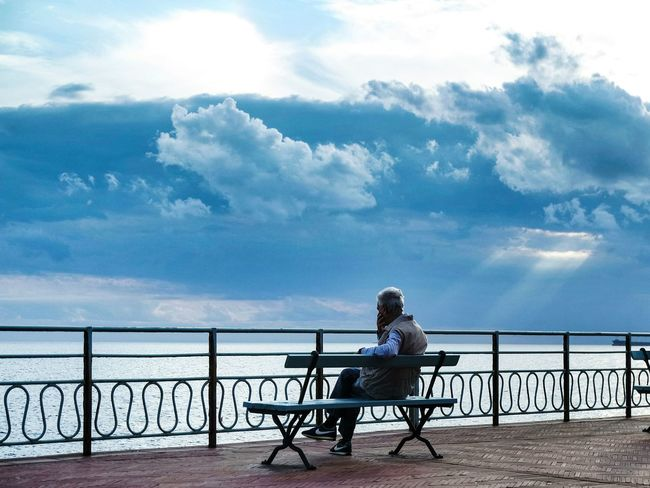 The weather theese days... Senior Adult One Person Sea Sitting Person Nature Relaxation Water Retirement Bench Chair Full Length Outdoors Gray Hair Sky Adult Beach Day Horizontal Cloud - Sky EyeEm Best Shots Fresh 3 Open Edit Eye4photography