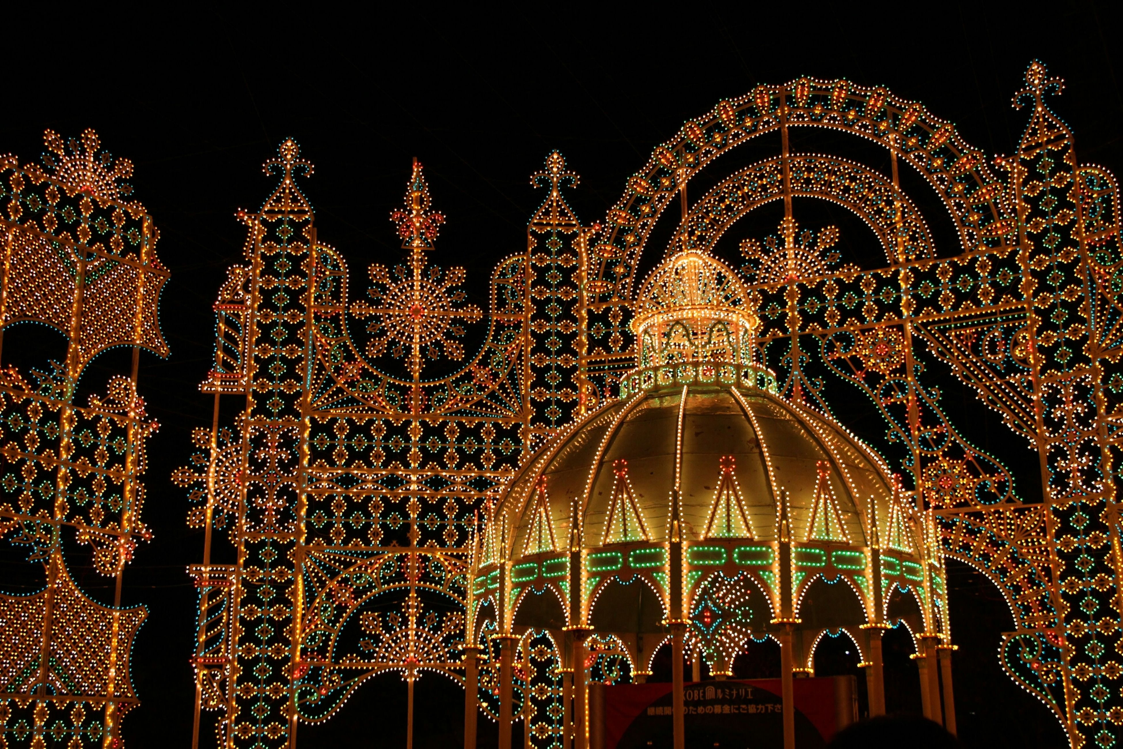 illuminated, night, religion, decoration, place of worship, spirituality, celebration, tradition, lighting equipment, low angle view, indoors, cultures, hanging, ornate, christmas lights, arts culture and entertainment, temple - building, christmas decoration, dark