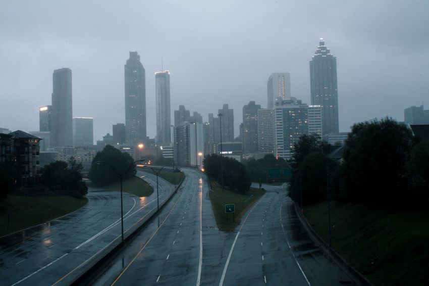 The Atlanta Skyline. Believe it or not this isn't photoshopped- there were no cars on the highway (taken during hurricane Irma) Skyscraper Architecture Building Exterior Built Structure City Cityscape Urban Skyline Outdoors Water Road Travel Destinations Fog Modern Sky Tall Day No People Tree Building Buildings Empty Road Street Photography Minimalism Simplicity Architecture_collection