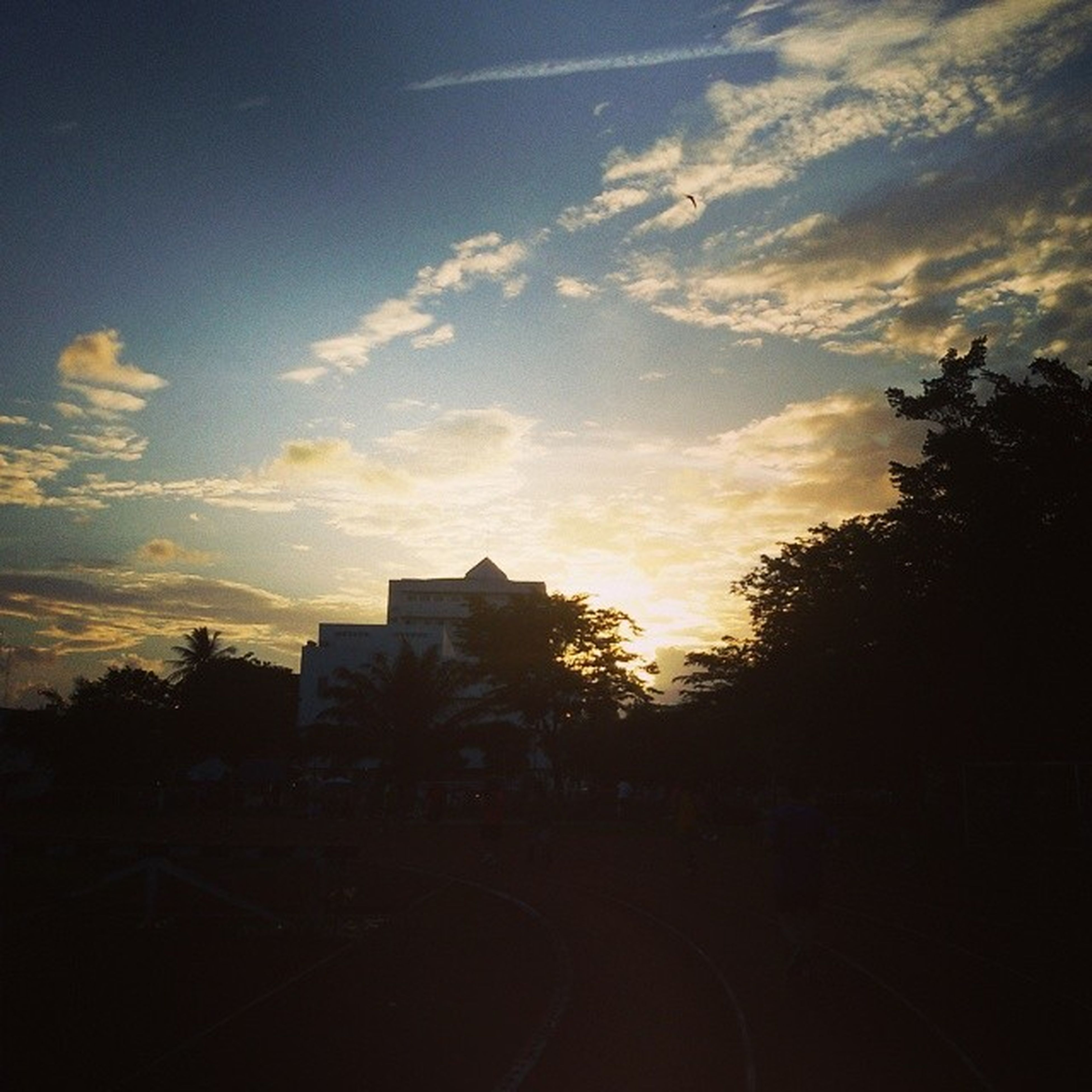 architecture, silhouette, building exterior, built structure, sunset, sky, tree, cloud - sky, road, city, cloud, dusk, outdoors, no people, house, building, dark, transportation, street, nature