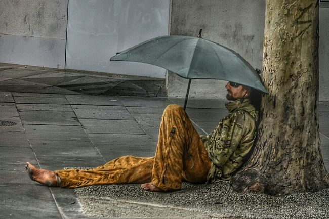 People Watching Bourke St - Melbourne Melbourne Vagrant Vagrancy Australia Chilling Taking A Break Interesting Individuality Original A Man In The City Eye4photography  Pastel Power EyeEm Gallery Fine Art Photography Road Man Sheltered Relaxed Shelter On The Streets Seated Umbrella The Street Photographer - 2016 EyeEm Awards