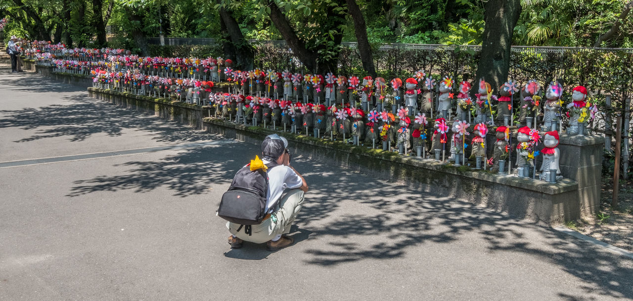 Little children statues represent unborn children, including miscarried, aborted, and stillborn in Zojoji Temple, Tokyo. Parents can decorate these statues with clothing and toys. Jizo Jizobosatusu Belief Believe Buddhism Cemetery Children Statue Culture Decorated Figurine  Japan Japanese  Little Religion Remembrance Representation Rows Sacred Shrine Statue Stone Temple Tokyo Tradition Zojoji
