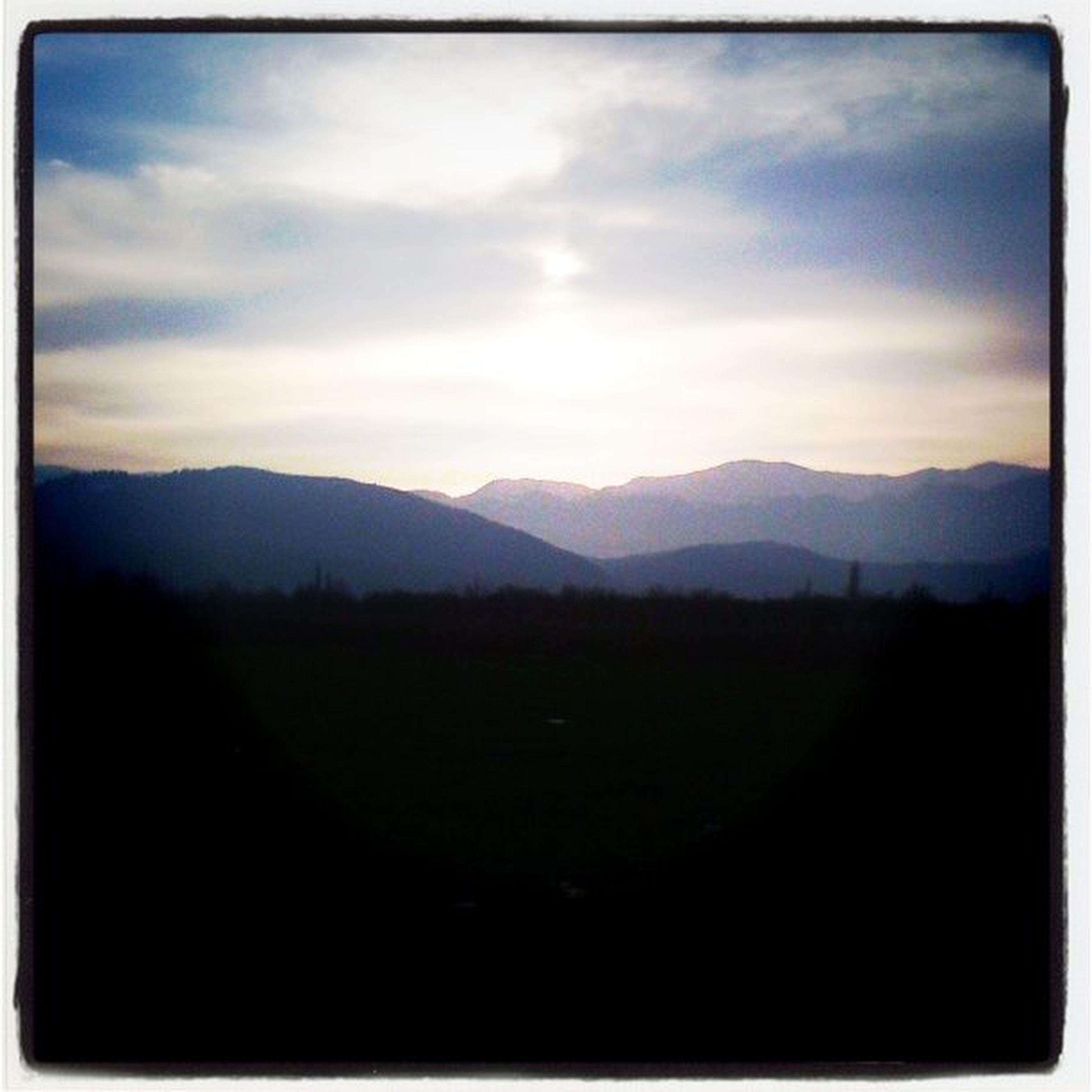 mountain, tranquil scene, mountain range, scenics, tranquility, landscape, sky, beauty in nature, silhouette, sunset, transfer print, nature, idyllic, cloud, cloud - sky, non-urban scene, dark, auto post production filter, horizon over land, non urban scene