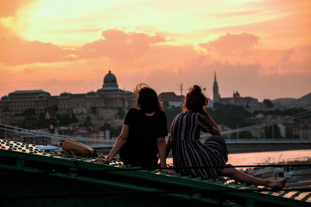 Bridge Budapest City Break Cityscape Danube Embrace Urban Life Enjoy The New Normal Enjoying Life Enjoying The View Friends Friendship Love Real People Rear View River Sunset Togetherness Two People Women Young Women Liberty My Year My View