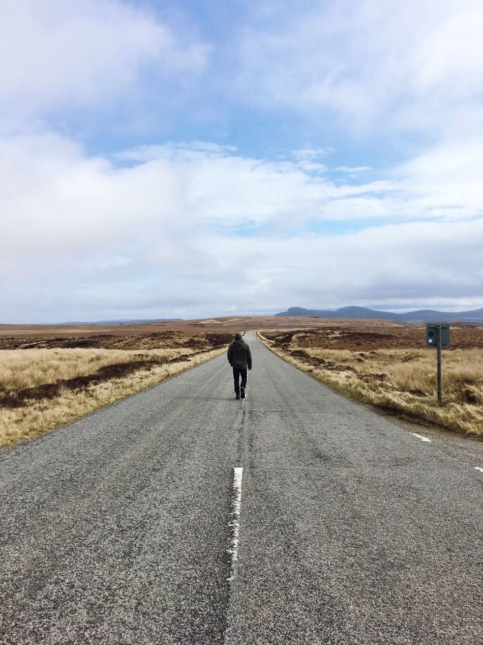 Road Rear View The Way Forward Landscape One Person Walking Scenics One Man Only Outdoors Nature Beauty In Nature Mountain Adventure Ontheroad No People Scotland Highlands Travel Travel Photography Traveling Travelling Alone Serene Outdoors Taking Photos