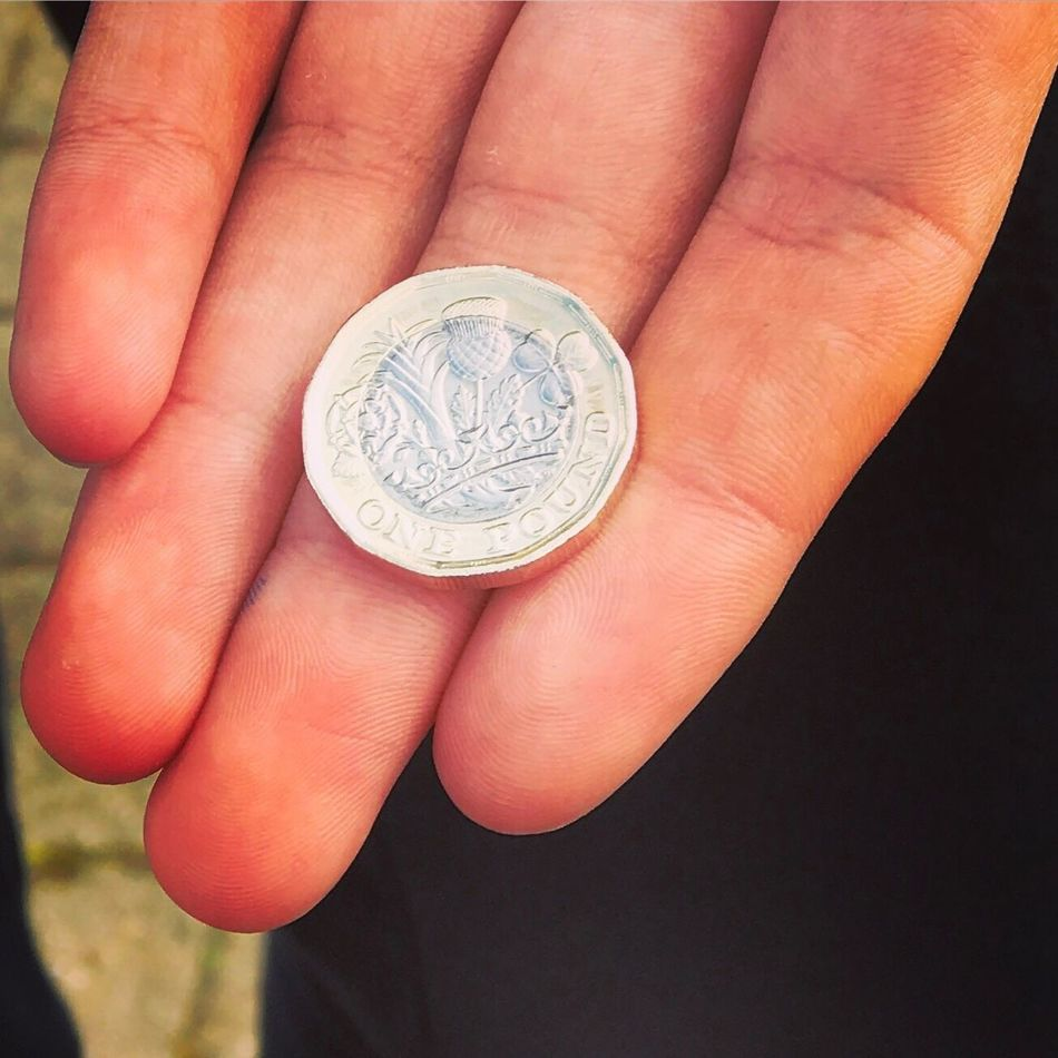 The new 12 sided UK one pound coin. Human Hand Human Body Part Finance Showing One Person Holding Wealth Close-up Currency Coin Outdoors People Day One Pound One Pound Coin Sterling Sterling Pound Uk England Hampshire  Isle Of Wight  Money Money Money Money Coins Coins Collection