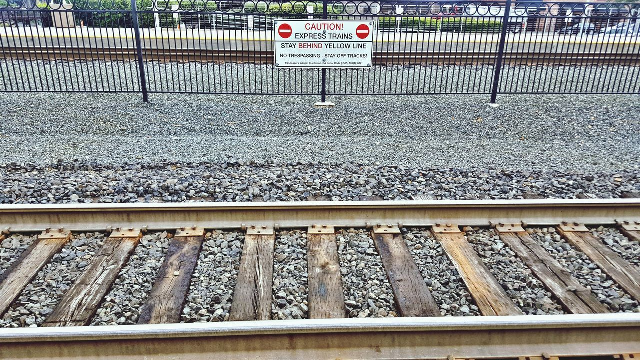 Railroad Track Transportation Rail Transportation Day Outdoors Railroad Tie No People Text Communication