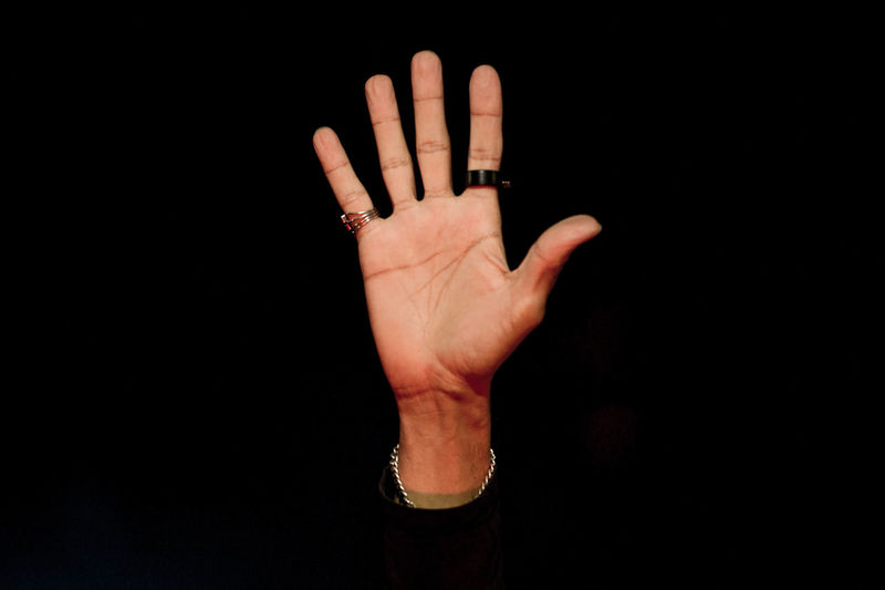 Black Background Close-up High Five Human Body Part Human Finger Human Hand One Person Palm People Real People Rings Stop Gesture Studio Shot