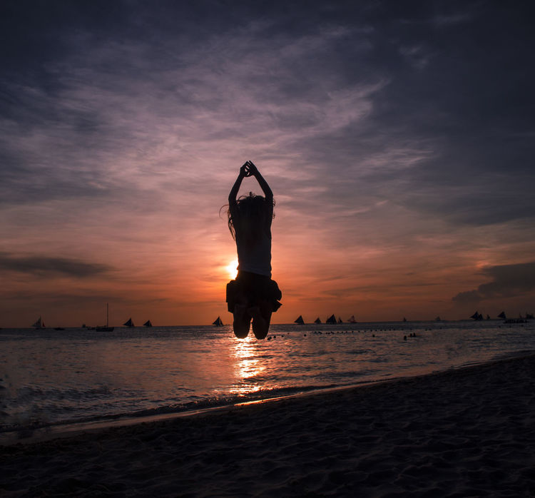 Beach Beauty In Nature Casual Clothing Cloud Cloud - Sky Enjoyment Freedom Full Length Horizon Over Water Idyllic Leisure Activity Lifestyles Nature Orange Color Outdoors Scenics Sea Shore Sky Sunset Tourism Tranquil Scene Tranquility Vacations Water