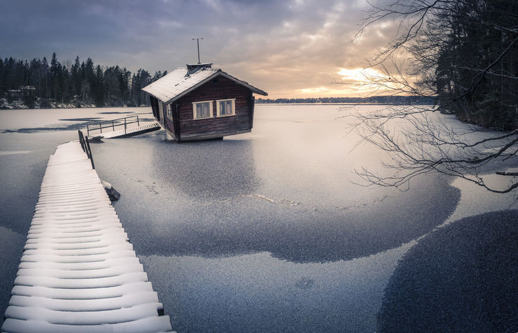 Scenic landscape with weird and abandoned cottage at winter in Finland Abandoned Places Blue Branches Cold Cottage Country Countryside Decay Evening Frosty Frozen House Ice Landscape Nature Pier Sauna Sky And Clouds Snow Sunset Trees Weird White Winter Worn Out