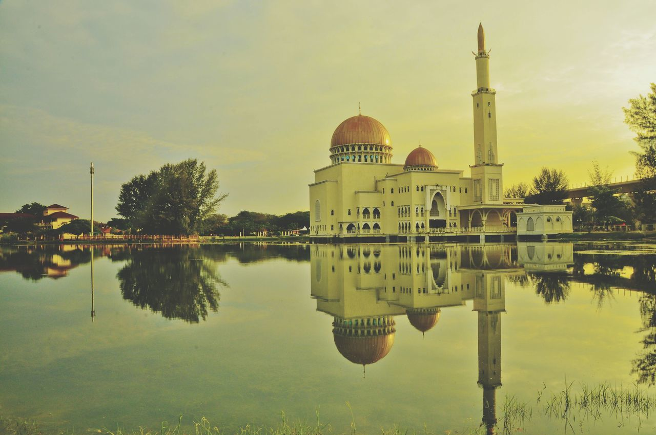 reflection, dome, water, travel destinations, waterfront, religion, architecture, built structure, building exterior, tree, lake, spirituality, place of worship, sky, outdoors, no people, day, nature