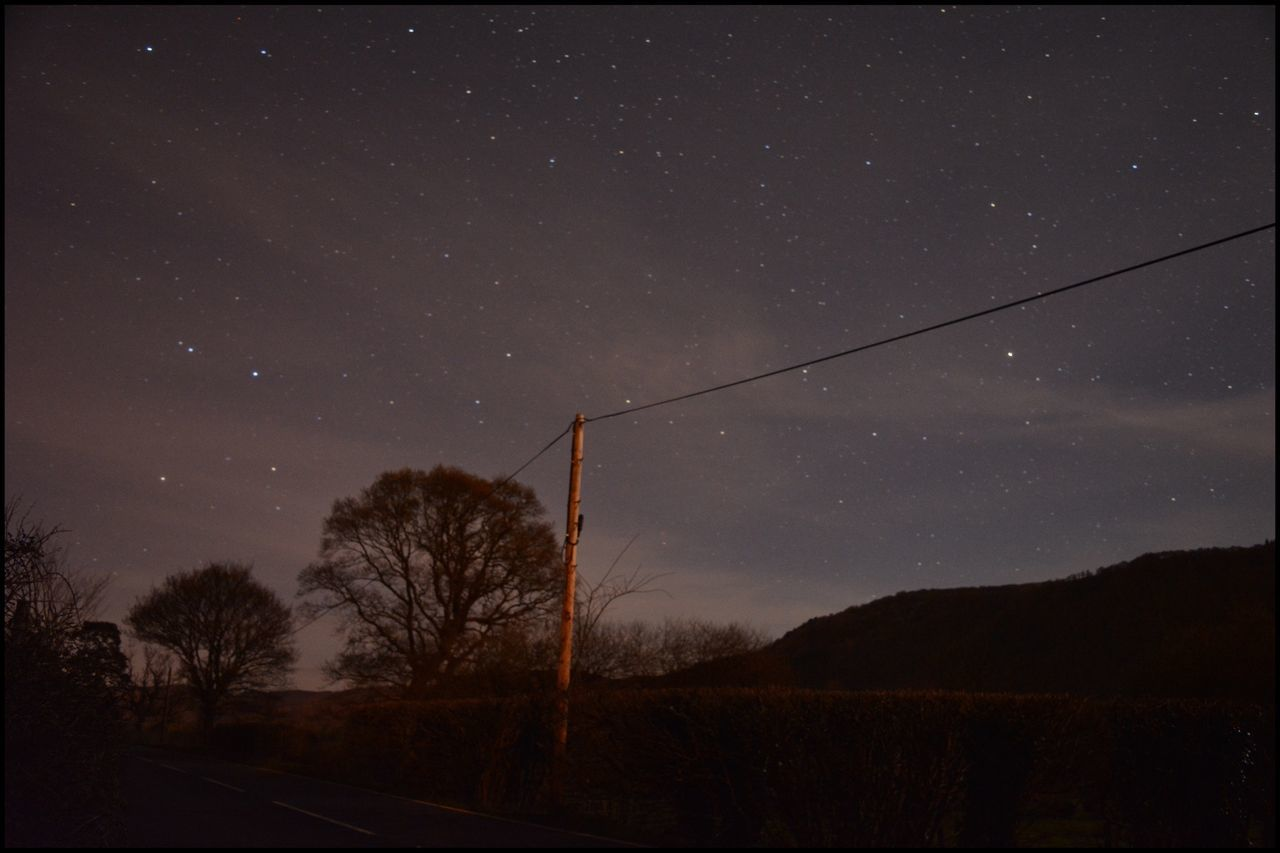 Starry Sky in Northwales Star - Space Tree Night Nature Silhouette Beauty In Nature Sky Tranquil Scene Scenics Tranquility Low Angle View No People Outdoors Astronomy Star Field Galaxy Landscape Telegraph Pole Stars Night Lights Nightphotography Eyemphotography EyeEm Best Shots